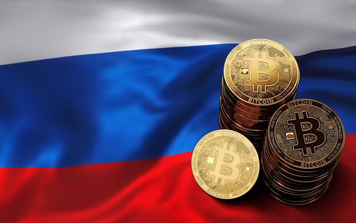bitcoins-stacked-on-russian-flag.jpg